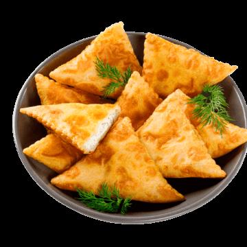 Замовити онлайн доставку Міні-Кальцоне з сиром і зеленню додому або офісу можна в усіх містах, де представлені фірмові магазини компанії Еліка